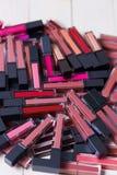 A lot of beautiful fashionable bright lipsticks, lip glosses, close-up, professional cosmetics royalty free stock photography