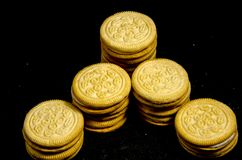 A lot of  big stack of sweet round cookie`s. A cookie is a baked or cooked food that is small, flat and sweet. It usually contains flour, sugar and some type of Stock Photo