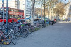 A lot of bikes parked on the sidewalk near the road. Berlin, Germany, December 2018. A lot of different bikes parked on the sidewalk near the road. Berlin stock image
