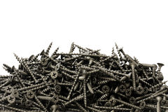 A lot of black drywall screws Royalty Free Stock Images