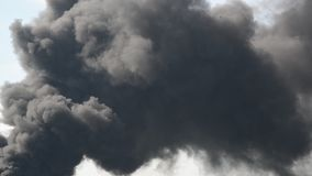 Lot of black smoke from the fire stock video footage