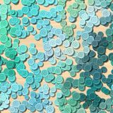 A lot of blue colored vintage clothing plastic buttons randomly scattered on the light woody background - top view. A lot of blue multi colored vintage clothing Vector Illustration