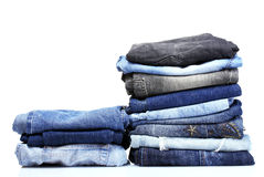 Lot of blue jeans Stock Images