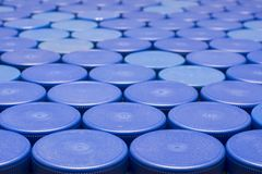 A lot of blue plastic bottle caps, close-up. royalty free stock photos