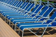 A lot of blue sunbed into a cruise ship Stock Photos