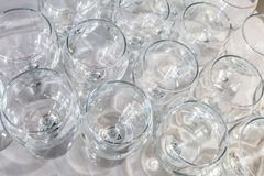 Lot of blurred empty glasses on reception party table stock photos