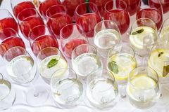Lot of blurred glasses with red and white wine on the reception party table.  stock images