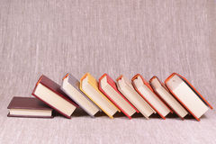 A lot of books on a linen background Stock Images