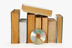 It is a lot of books and one compact disc. Isolated on a white background Royalty Free Stock Images