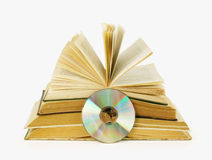 It is a lot of books and one compact disc. Isolated on a white background Royalty Free Stock Image