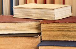 Lot of books on the table in the library Royalty Free Stock Image