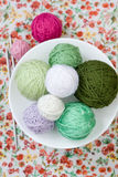 A lot of bright balls of knitting on the background Royalty Free Stock Image