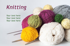 A lot of bright balls of yarn and needle Stock Images