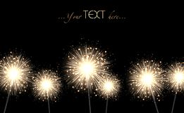 A lot of bright gold sparklers on a black background. Stylish background for wide application. There is a place for additional text elements and the logo Royalty Free Stock Photo