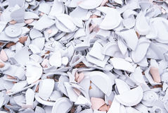 A lot of broken porcelain plates Stock Photo