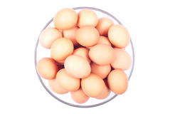 A lot of brown eggs in a large glass bowl isolated on white back Stock Photo