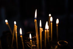 A lot of of burning candles. In a church Stock Image