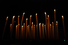 A lot of burning candles on a dark background Royalty Free Stock Photography