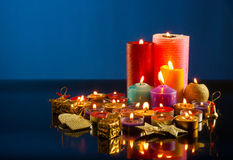 A lot of burning colorful candles Stock Photos