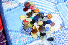Lot of buttons placed on a quilting Stock Photography