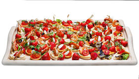 Lot of canape with  shrimp, caviar, strawberries Stock Photos