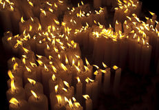 A lot of candles. Yellow Stock Photography