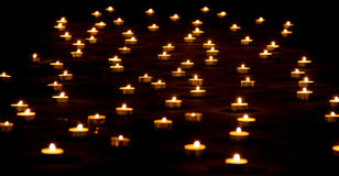 Lot of Candles on Ground Stock Photos