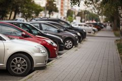 Cars in city parking lot. stock photography