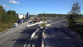 Lot of cars go round the construction site of the temporary multi-lane road. Time Lapse. ESPOO, FINLAND - SEPTEMBER 15, 2016: Lot of cars go round the stock footage