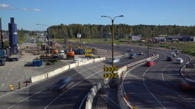 Lot of cars go round the construction site of the temporary multi-lane road. Time Lapse. ESPOO, FINLAND - SEPTEMBER 15, 2016: Lot of cars go round the stock video footage