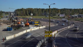 Lot of cars go round the construction site of the temporary multi-lane road. Time Lapse. ESPOO, FINLAND - SEPTEMBER 15, 2016: Lot of cars go round the stock video