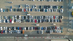 Cars in the parking lot near the shopping cente. A lot of cars in the parking lot Stock Image