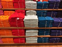 Lot of casual t-shirts on shelf Stock Photography