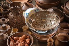 Various ceramic dishes handmade in the potter`s shop Stock Images