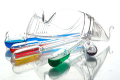 A lot of chemical glass. A lot of retorts and other chemical glass filled with coloured liquids Royalty Free Stock Photos