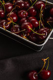 A lot of  cherries on black background , close-up frame Stock Photo