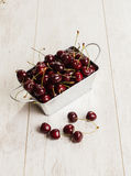 A lot of  cherries on wooden table,close-up Royalty Free Stock Photo