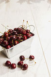A lot of  cherries on wooden table,close-up Royalty Free Stock Photography