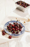 A lot of  cherries on wooden table Stock Photo