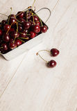 A lot of  cherries on wooden table Stock Photography