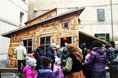 Epiphany house. A lot of children in front of the house of befana at urbania. befana is a italian witch that in epiphany days gives presents to the good children Stock Photography