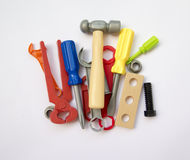 A lot of children's toy instruments gathered in a pile, bright c Stock Photos