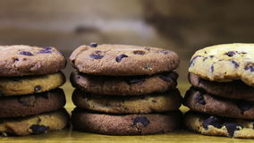 Lot of chip cake cookies with chocolate close-up tilting stock video footage