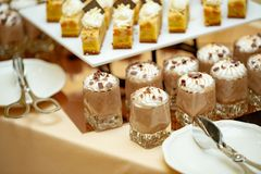 A lot of chocolate desserts in shot glasses, close-up. Reception royalty free stock image
