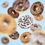 Lot of chocolate flying of falling donuts stock image