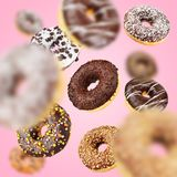 Lot of chocolate flying of falling donuts royalty free stock image