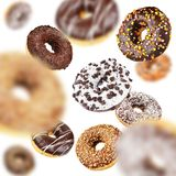 Lot of chocolate flying of falling donuts stock photos