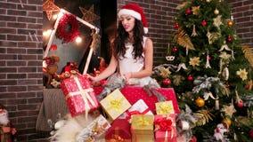 Lot Christmas gift, portrait, pretty girl Santa Claus stock video