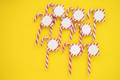 A lot of christmas candies on yellow background royalty free stock photo