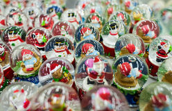 Lot of Christmas snow globes with Santa Clauses inside Royalty Free Stock Photos